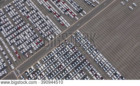 Aerial Top View Of New Cars Parking For Sale Stock Lot Row, Dealer Inventory Import And Export Busin