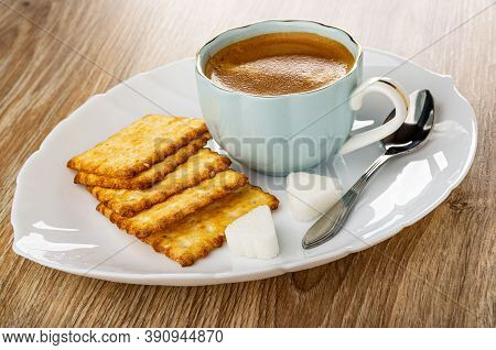 Crunchy Cookies With Sesame, Coffee Espresso In Light-blue Cup, Pieces Of Sugar, Spoon In White Dish