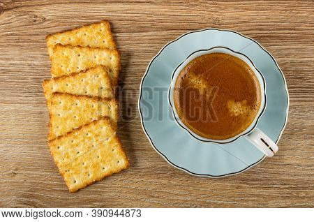 Few Crunchy Cookies With Sesame, Coffee Espresso In Light-blue Cup On Saucer On Wooden Table. Top Vi