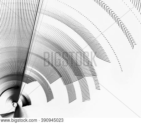 Black Transparent Blades Rotate On A White Background. The Blades Are Directed At Different Angles.