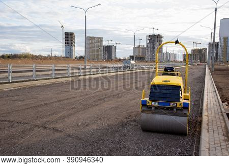 Paving Roller Machine During Road Work. Mini Road Roller At Construction Site For Paving Works. Scre