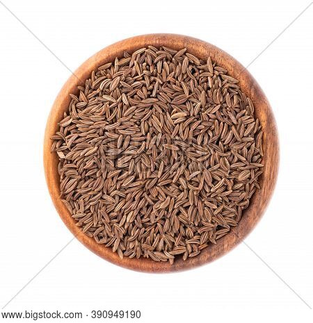 Cumin Seeds In Wooden Bowl, Isolated On White Background. Cumin Seeds Or Caraway. Top View.