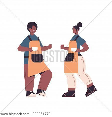 African American Man Woman In Uniform Working In Cafe Waiters In Apron Serving Coffee Full Length Is