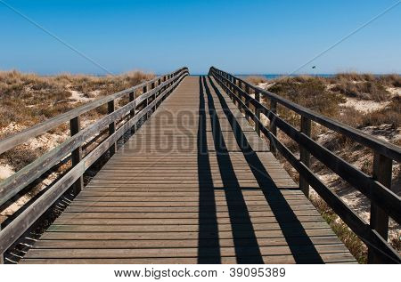 Wooden Walkway On Beach