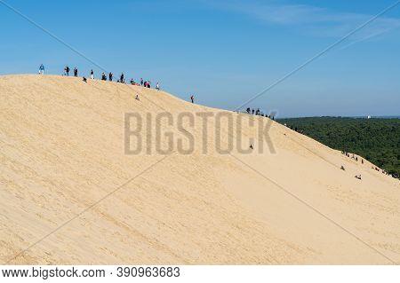 Arcachon, Gironde / France - 18 October 2020: Many Tourists Enjoy A Visit To The Ladnark Dune De Pil