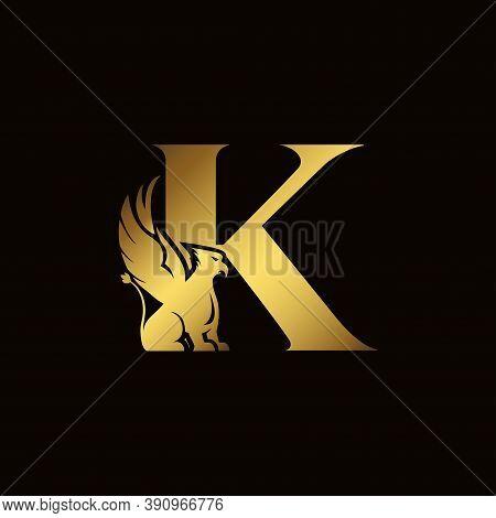 Griffin Silhouette Inside Gold Letter K. Heraldic Symbol Beast Ancient Mythology Or Fantasy. Creativ