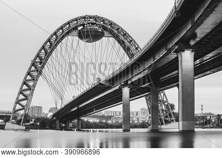 Scenic View Of Zhivopisny Bridge In Moscow, Russian Federation. Photoshoot Of The Arch, A Steel Cabl