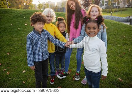 Togetherness. Interracial Group Of Kids, Girls And Boys Playing Together At The Park In Summer Day.