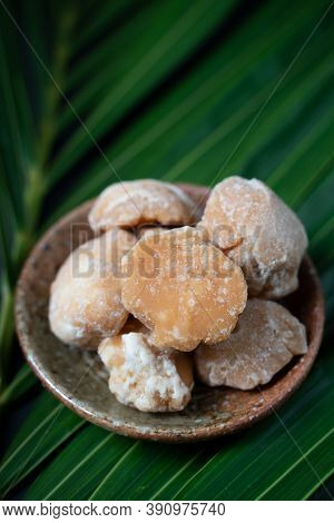 Organic Brown Palm Sugar Or Coconut Sugar, Made From Coconut Juice With Green Coconut Leaves.