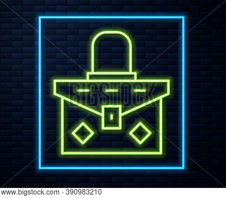 Glowing Neon Line Handbag Icon Isolated On Brick Wall Background. Female Handbag Sign. Glamour Casua