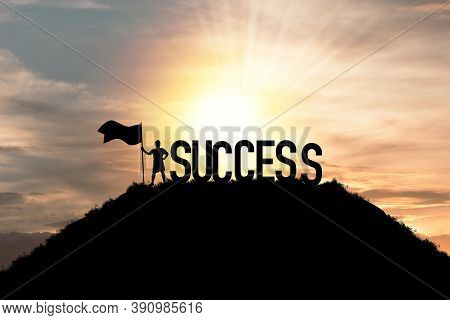 Silhouette Business Man Standing And Holding Flag With Success Wording On The Top Of Mountain, Busin