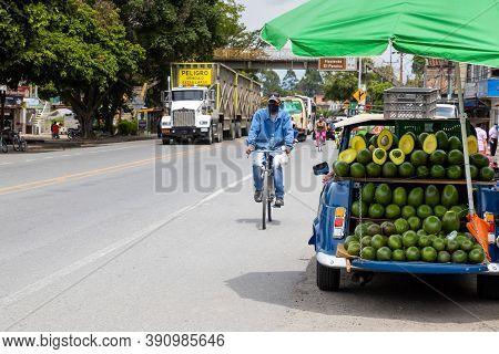 El Cerrito, Colombia - October, 2020:  Street Sell Of Avocado At An Old Car At El Cerrito On The Val