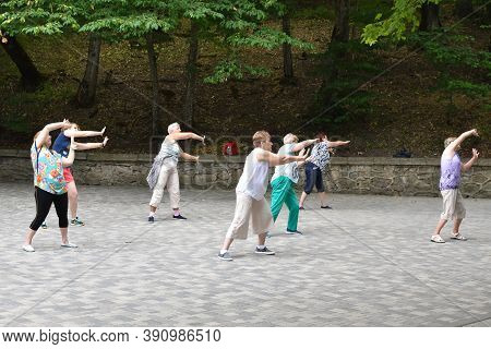 Moscow. Russia. August 2020. A Group Of Women Doing Physical Exercises In Outdoor Park. Healing Medi