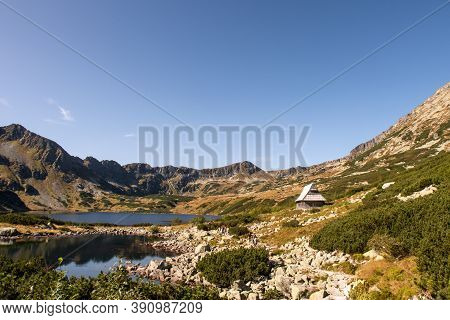 Five Polish Ponds Valley Landscape In High Tatra Mountains With Czarny Staw Polski Lake And Small Wo