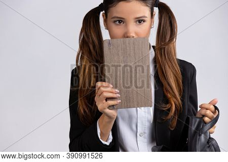 Discouraged Female Student Holding A Blocnotes With Free Space Isolated On Gray Background. Social P