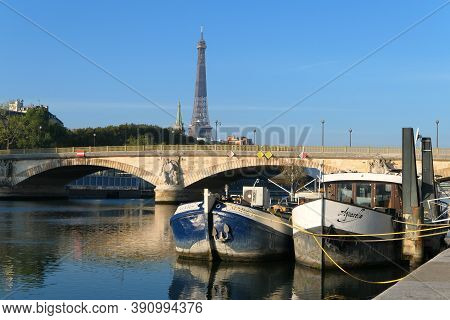 Paris, France. October 18. 2020. River Seine With Barges In The Foreground. View Of The Invalides Br