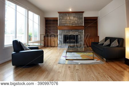 Family Room Remodeled With Gas Insert Fireplace Operating In Background