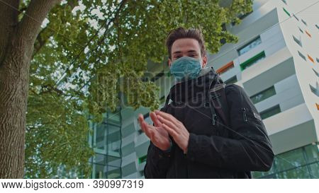 Portrait Of A Young Guy Wearing A Mask And Thank The Doctors For Their Efforts. The Teenager Stands