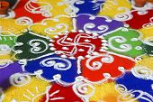 Multi colored patterned rangoli design a ritual performed by hindus generally during the hindu new year and divali along with the light of diwas poster