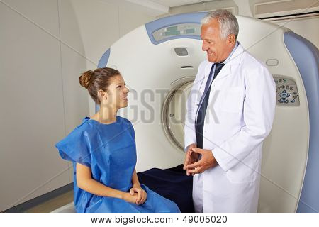 Radiology doctor explaining MRI to patient in a hospital