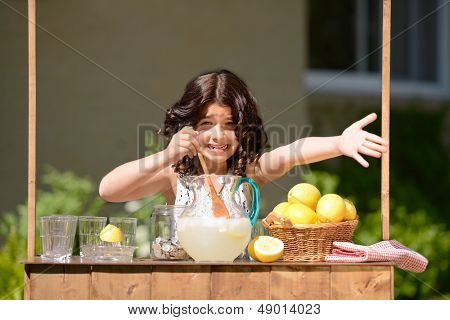 little girl trying to sell lemonade