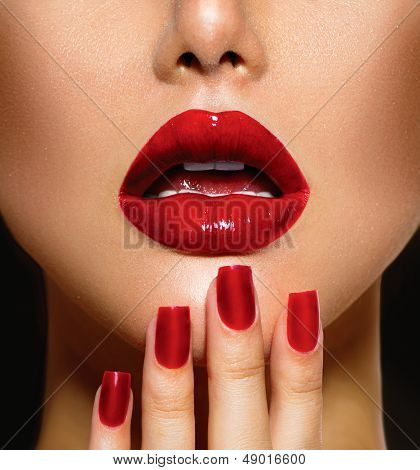 Red Sexy Lips and Nails closeup. Open Mouth. Manicure and Makeup. Make up concept. Kiss