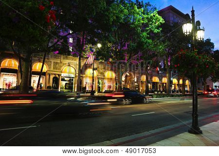 BEVERLY HILLS, CALIFORNIA, USA - JULY 27, 2013 : Cars passing the Beverly Wilshire Hotel on Wilshire Boulevard in Los Angeles on July 27, 2013 in Beverly Hills, California.
