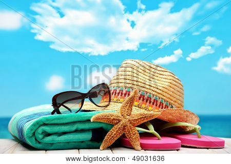 summer beach accessories on sandy beach
