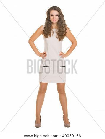 Full Length Portrait Of Serious Young Woman