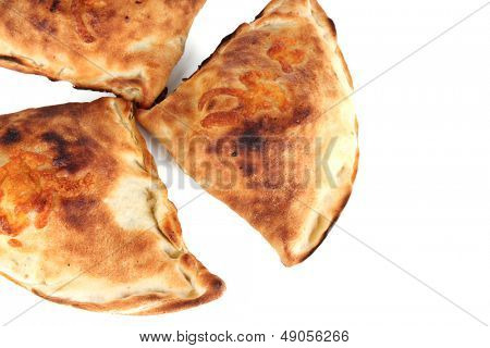 Pizza calzones isolated on white