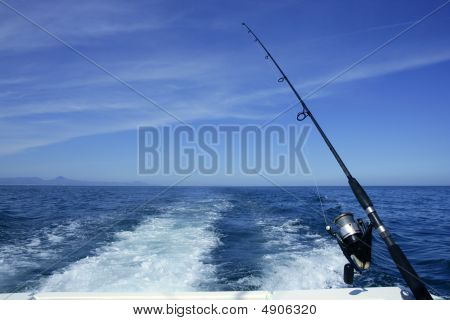 Fishing Rod And Reel On Boat,  In Blue Ocean