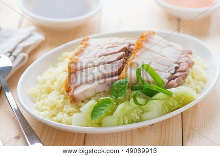 Siu Yuk or sliced Chinese boneless roast pork with crispy skin, serve with steamed rice. Hong Kong Chinese cuisine.
