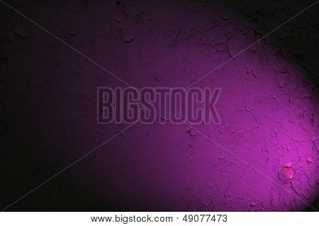 Cracked Purple Wall With Spotlight