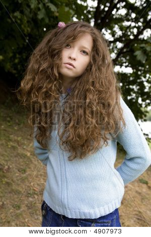 Young Attractive Woman With Clover In Hair