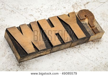 why question in vintage letterpress wood type on a ceramic tile background