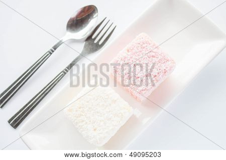 Set Of Pink And White Lamington Sponge Cakes