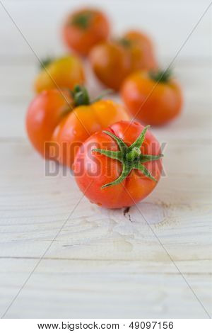 Freshly picked organic tomatoes on wooden table