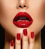 Red Sexy Lips and Nails closeup. Open Mouth. Manicure and Makeup. Make up concept. Kiss  poster