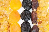 Composition from dried fruits on a light background poster