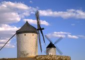 The windmills on the Spanish plains of La Mancha inspiration for the legend of Don Quixote and his servant Sancho Panza slaying the dragons (windmills) for the favor of the beautiful Dulcinea. poster