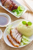 Siu Yuk or crispy roasted belly pork Chinese style and roast duck, served with steamed rice. Singapore Chinese cuisines. poster