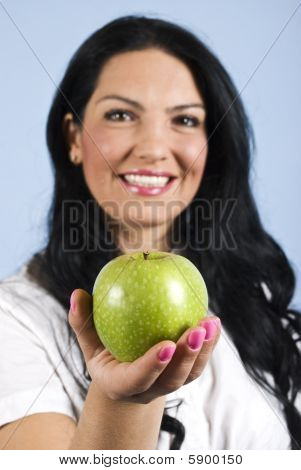 Happy Woman Offering An Apple