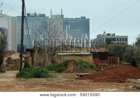 Abandoned Neighborhood And Modern Buildings