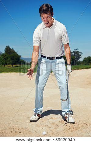 Golfer golf man having meltdown in bunker frustration