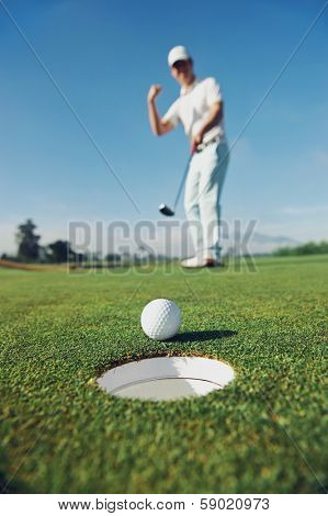 Golf man putting on green for birdie while on vacation poster