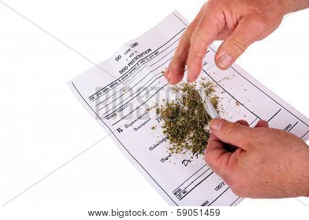 A medical Marijuana user rolls a Joint with rolling papers over his Medical Marijuana certificate in order to smoke some pot and relieve all his pain and suffering from ills real and imaginary  poster