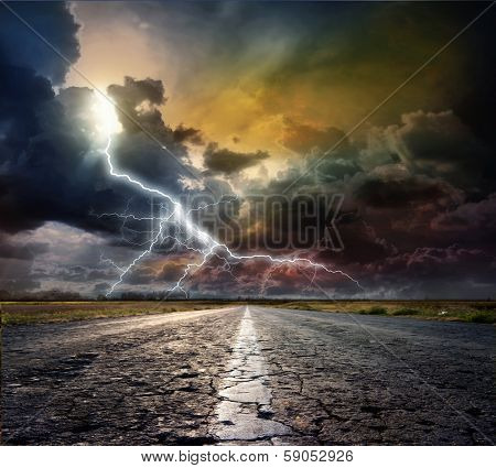 The asphalted road and thunderstorm with lightning