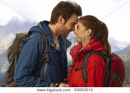 Young attractive couple treking outside, love each other.