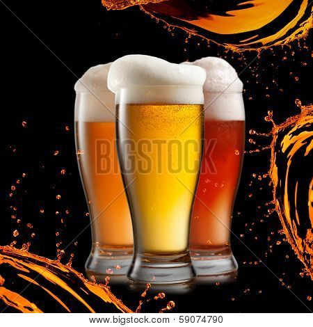 Different beer in glasses wish splash isolated on black background