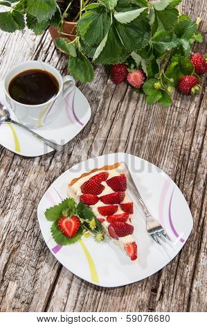 Stawberry Cake And A Cup Of Coffee